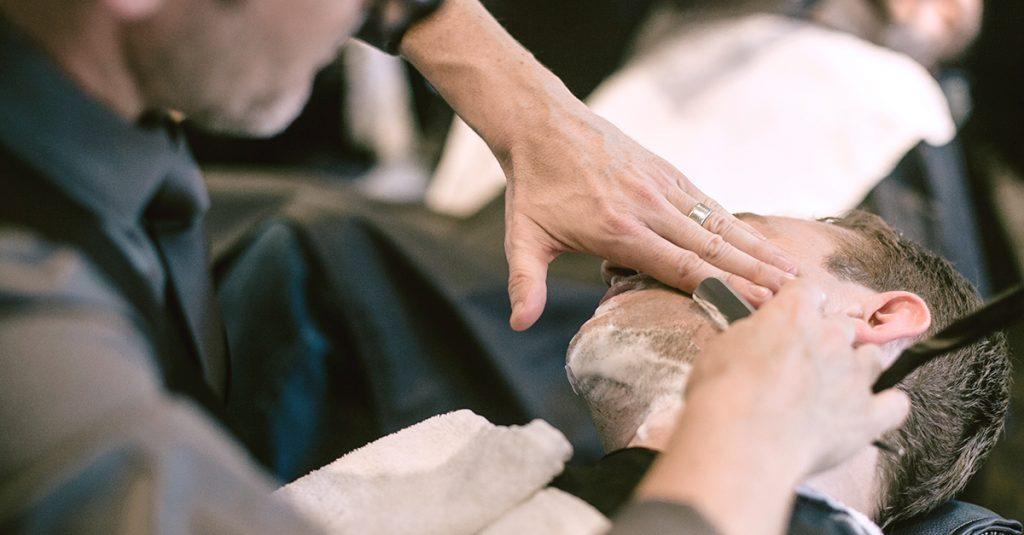 Ian Daburn giving a man a shave.