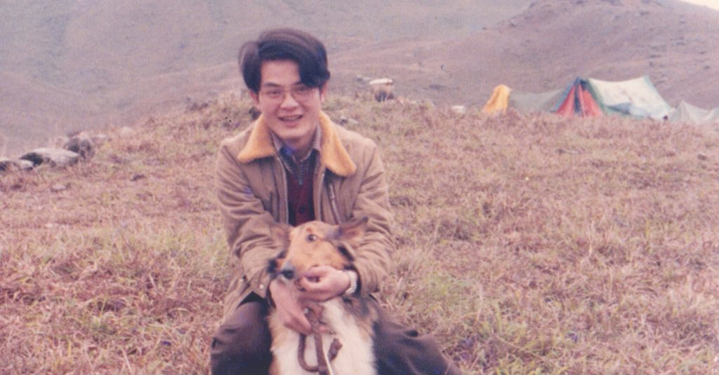 Lawrence Yu's dad and his dog.