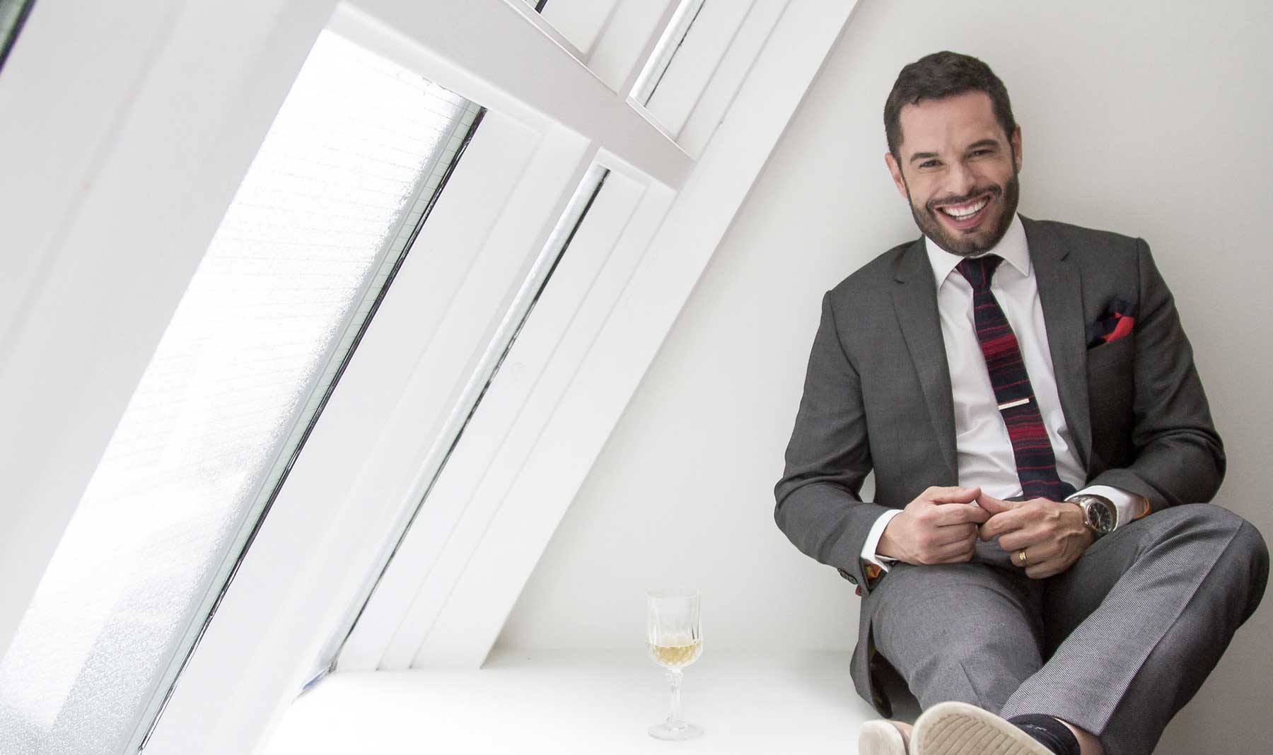 Mathieu Chantelois, Executive Director of Pride Toronto, wears our Dark Gray Birdseye Suit.