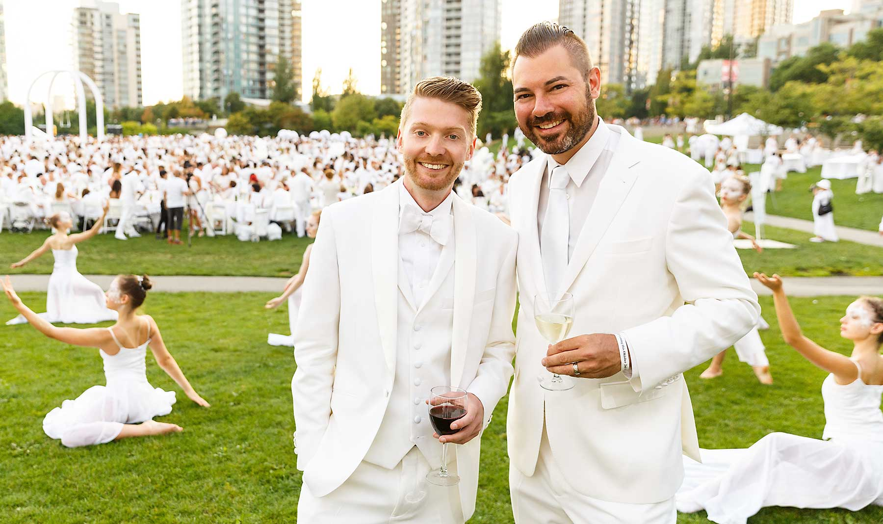 Dîner en Blanc Vancouver hosts Jordan Kallman and Tyson Villeneuve of The Social Concierge wearing white suits from Indochino.