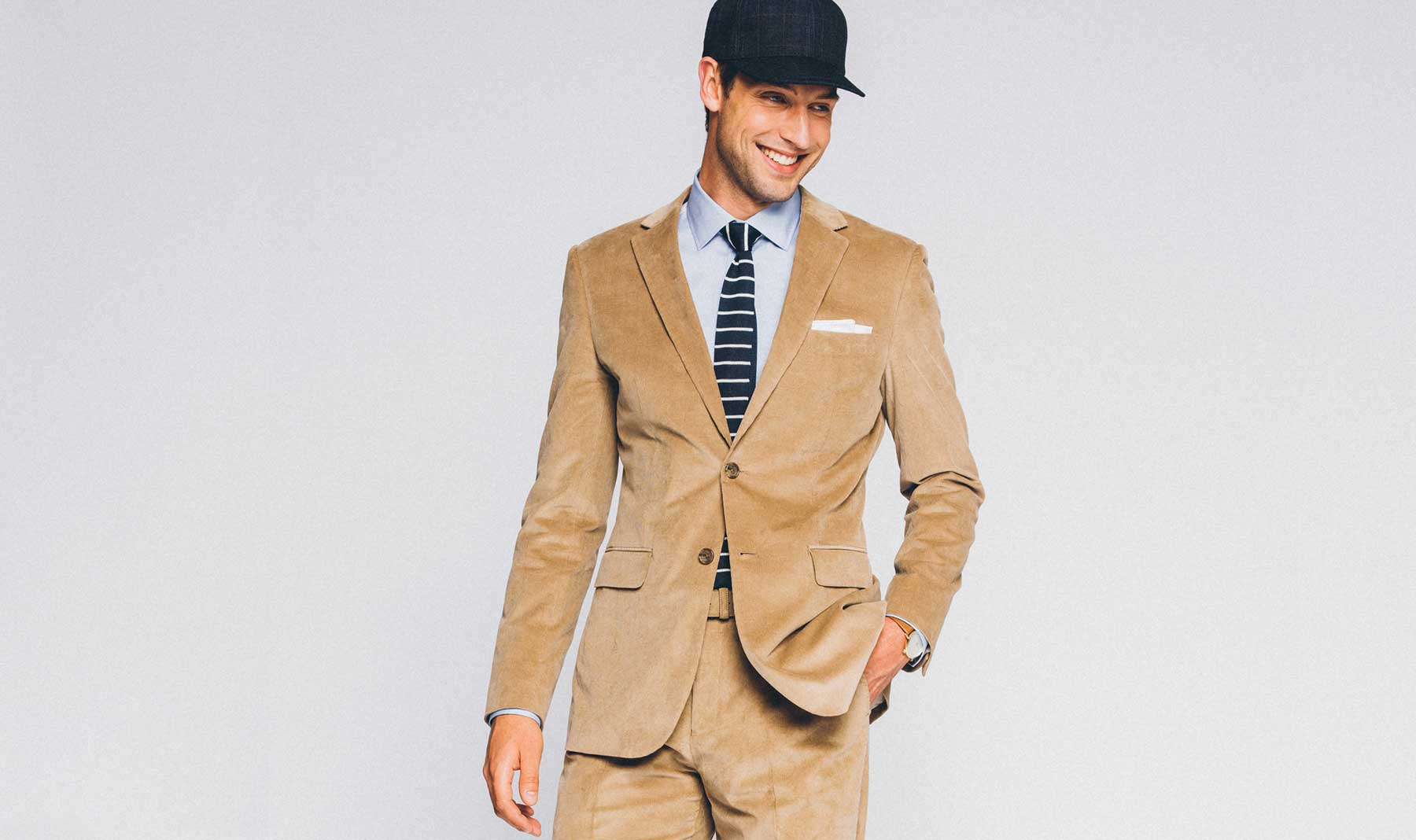 Keeping it cool and casual in a tan corduroy suit.