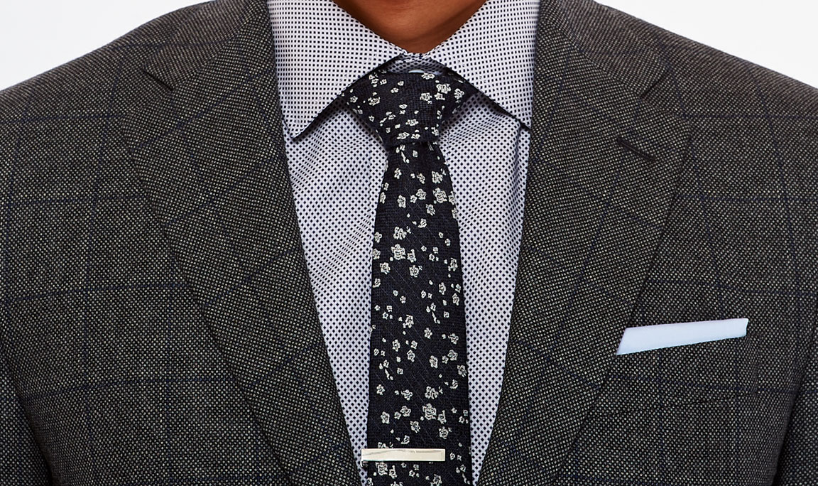 Master patterns with a bold tie and windowpane suit.
