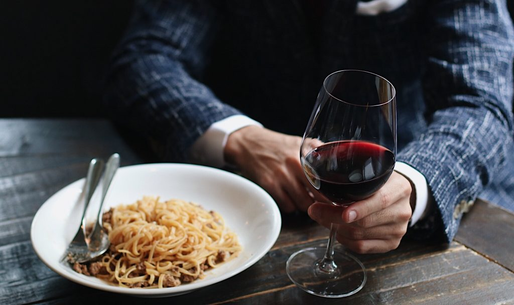 Perfect pairing—wine, pasta and Italian fabrics.